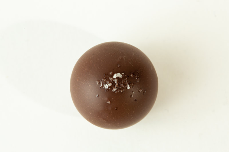 Dark chocolate with with a creamy dark ganache and salted caramel.