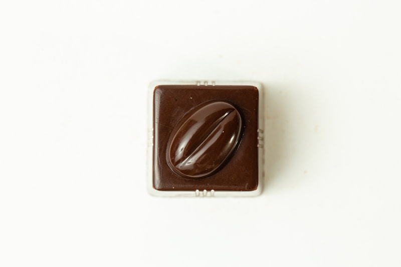 Dark Chocolate filled with a creamy milk chocolate and coffee ganache.